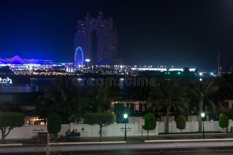 Night view of Abu Dhabi city famous Marina Mall, Marina eye wheel and Fairmont Marina Residences royalty free stock photos