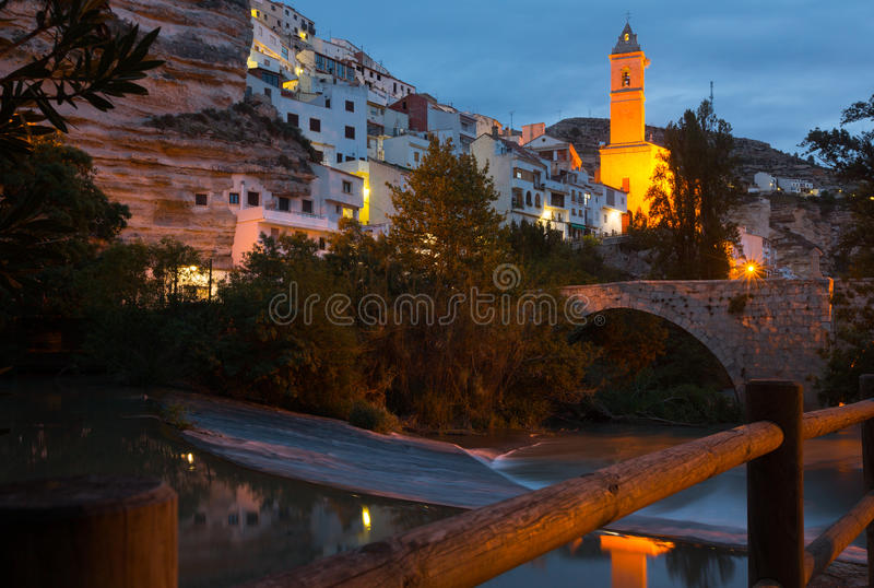 Night view of Alcala del Jucar with bell tower and bridge. Province of Albacete, Spain royalty free stock photos