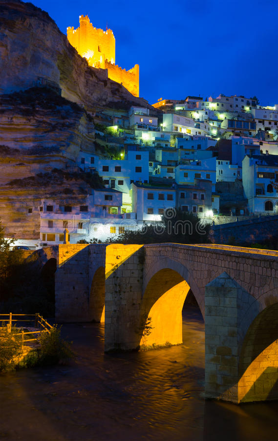 Night view of Alcala del Jucar with bridge. Province of Albacete, Spain stock photography
