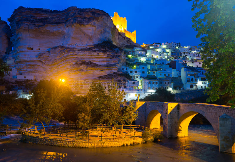 Night view of Alcala del Jucar with castle and bridge. Province of Albacete, Spain royalty free stock photos
