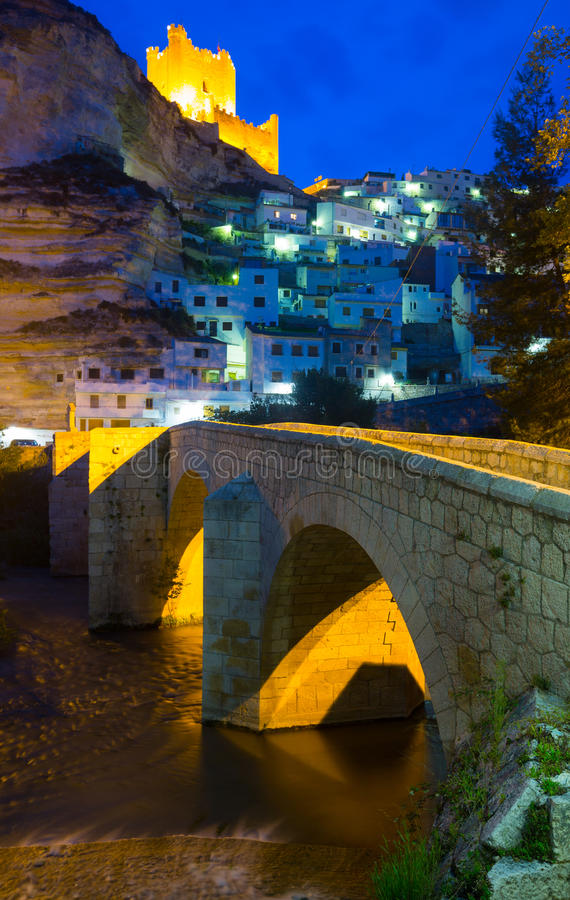 Night view of Alcala del Jucar with castle and bridge. Province of Albacete, Spain stock image