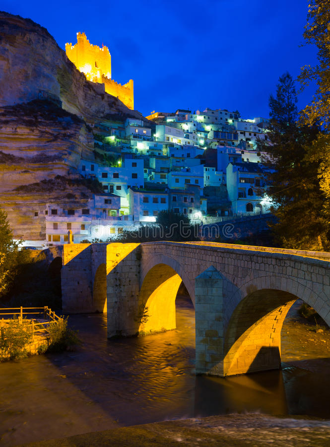 Night view of Alcala del Jucar with river and bridge. Province of Albacete royalty free stock photos