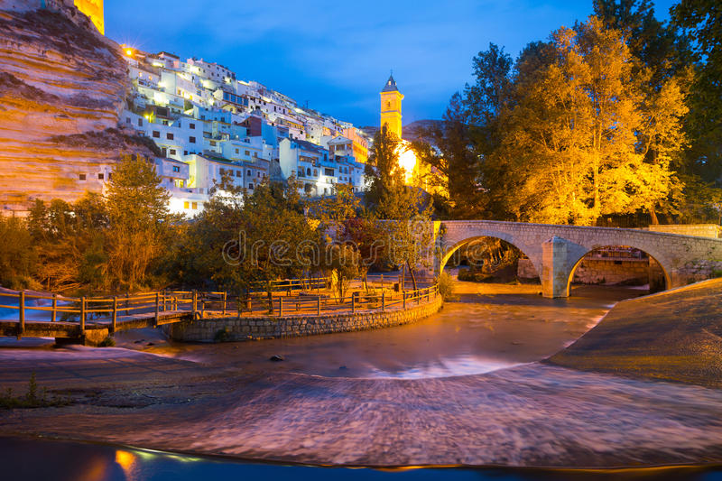 Night view of Alcala del Jucar with river and bridge. Spain stock images