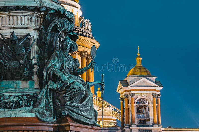 Night view of the ancient statues of stucco and the dome of St. Isaac`s Cathedral Saint-Petersburg. Night view of the ancient statues of stucco and the dome of royalty free stock photography