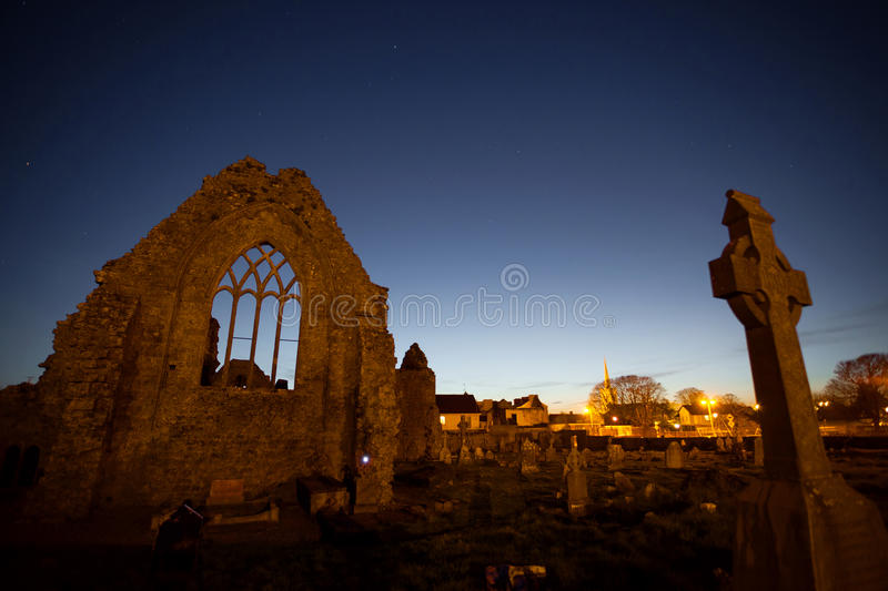 Night view of Athenry Dominican Friary. Dedicated to Saints Peter and Paul,found at 1241, with cemitary royalty free stock photography
