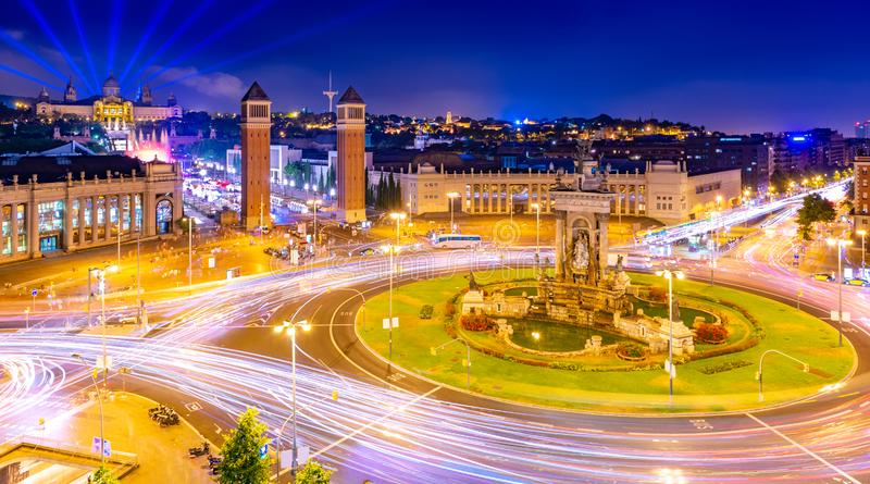 Night view of Barcelona from the trade center Arenas de Barcelona. The central square Plaça d`Espanya with numerous traffic light trails and  historical royalty free stock photography