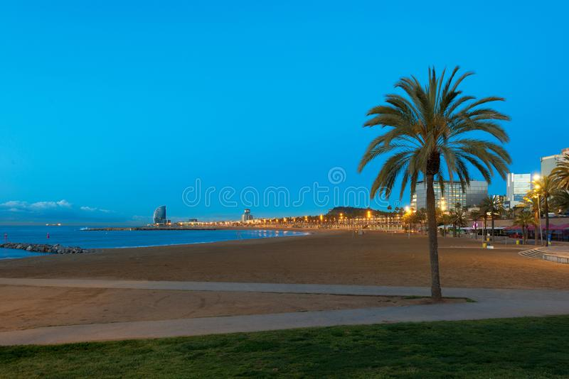 Night view of Barceloneta Beach in Barcelona with colorful sky at night. Seafront, beach,coast in Spain. Suburb of Barcelona,. Catalonia royalty free stock photo