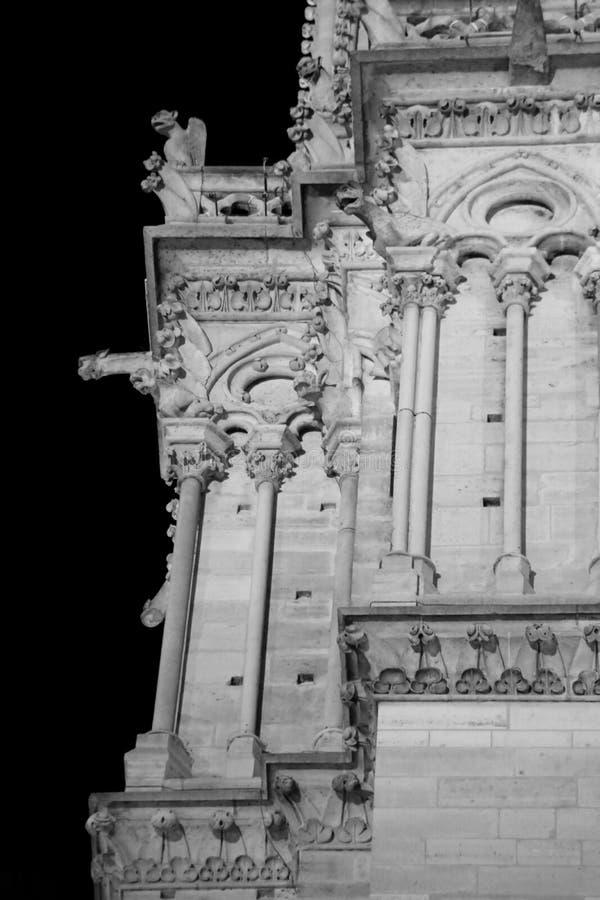 Night view of Basilica of Notre Dame de Paris with black and whi. Night view of Basilica of Notre Dame de Paris in France with black and white toned effect stock image