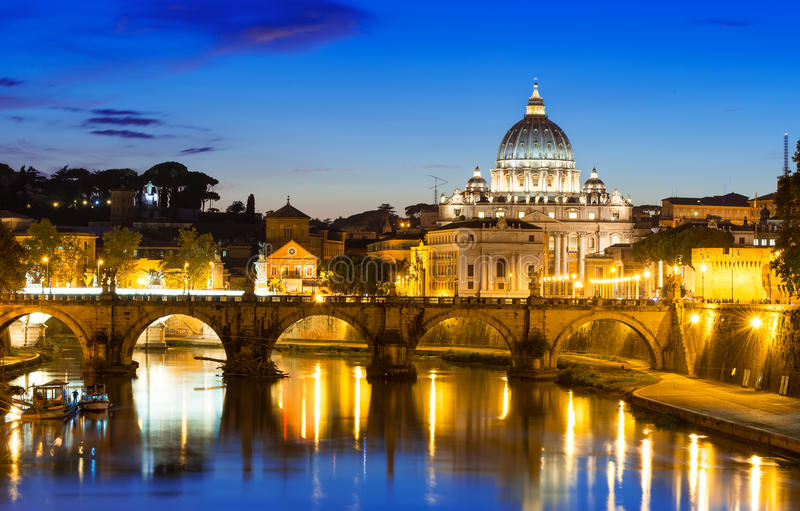 Night view of Basilica St. Peter and river Tiber in Rome stock image