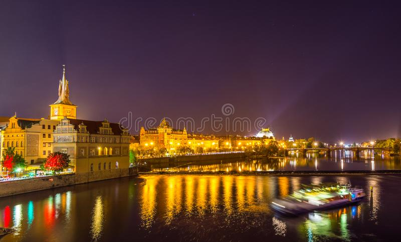 Night view of beautiful building  at the bank and the reflection on the  Vltava River, view from the Charles bridge, one of the stock photos