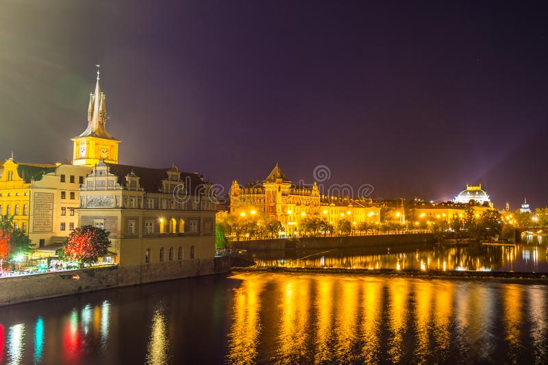 Night view of beautiful building  at the bank and the reflection on the  Vltava River, view from the Charles bridge, one of the stock image