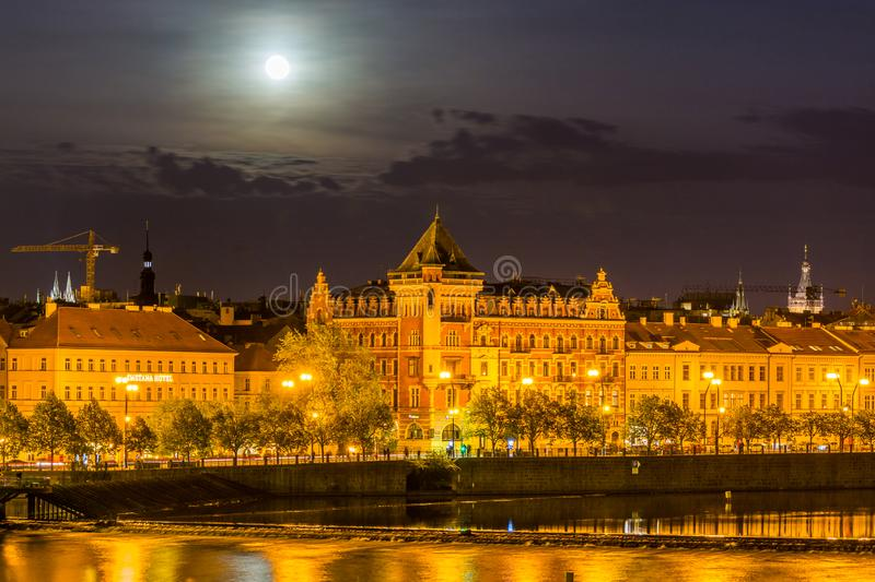 Night view of beautiful building  at the bank and the reflection on the  Vltava River, view from the Charles bridge, one of the stock photo