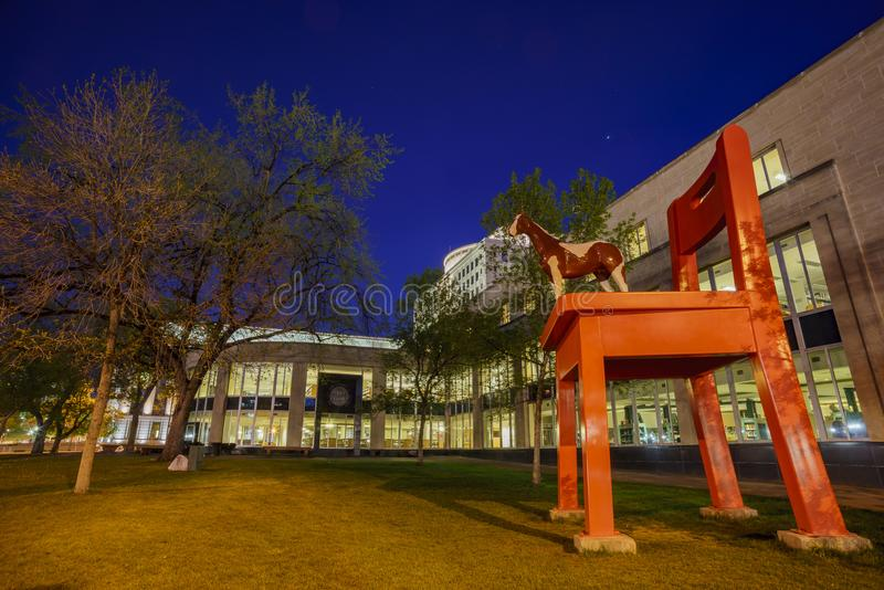 Night view of the Big red chair and horse statue of the Denver C. Entral Library in the Civic center stock images