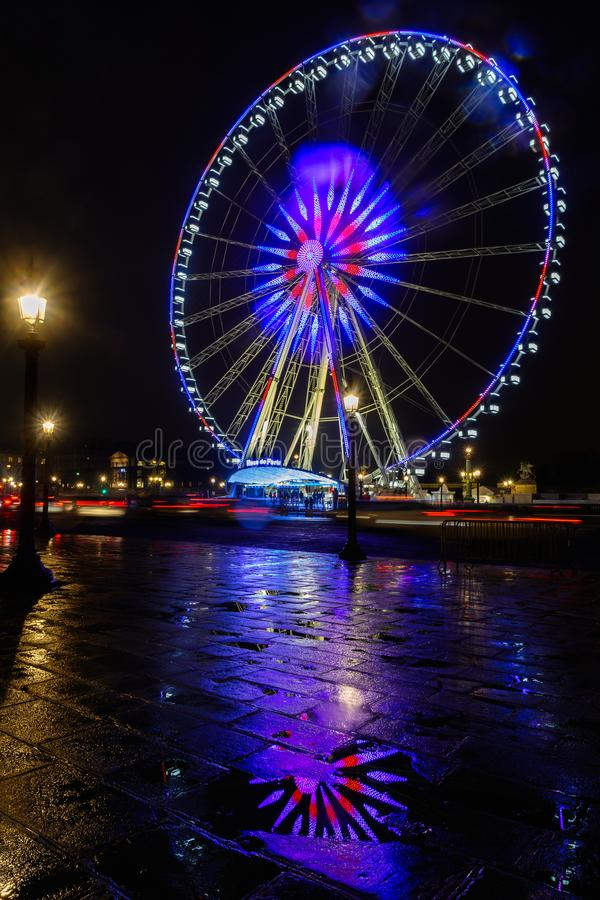 Night view of big wheel in Paris stock images