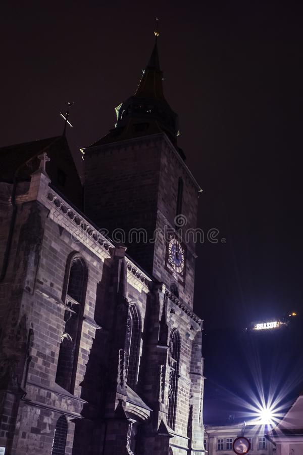 Night view of the Black Church from Brasov, Transylvania. Vertical stock images