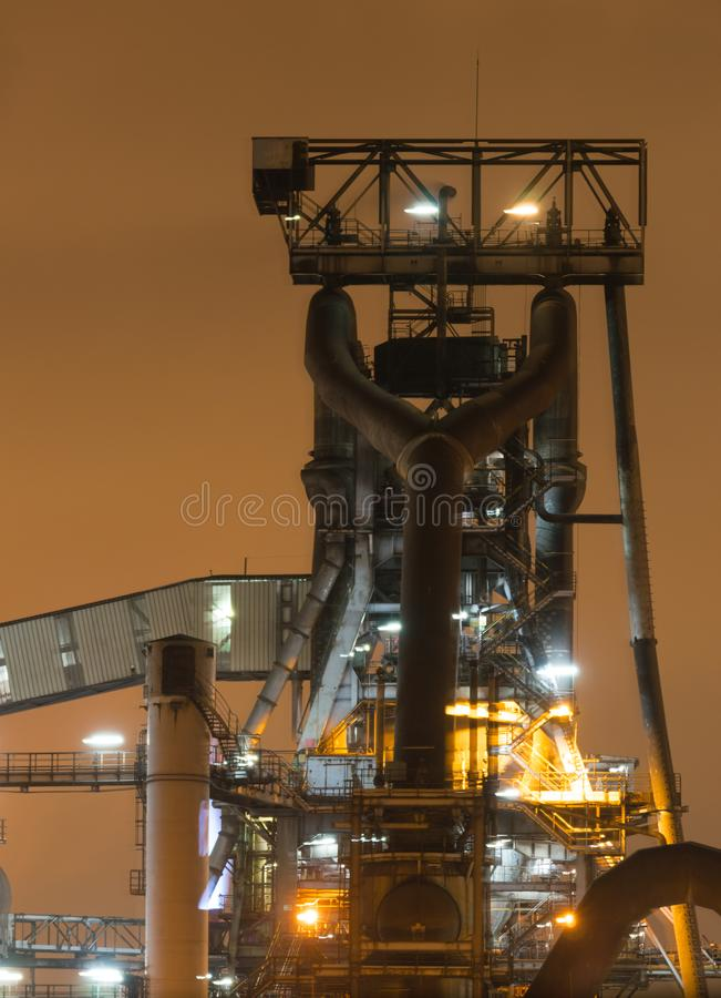 Night view of blast furnace equipment of the metallurgical plant, or steel mill. royalty free stock photography