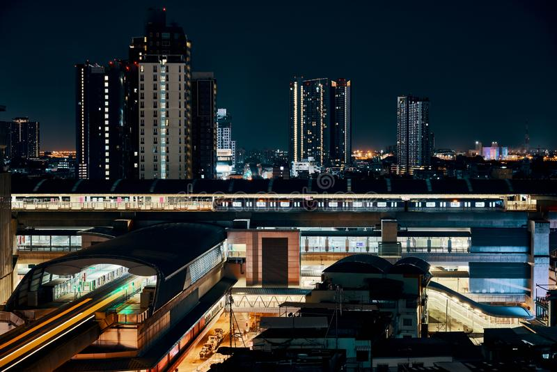 Night view of BTS sky train running in Bangkok. Night view of BTS sky train running in downtown of Bangkok royalty free stock photography