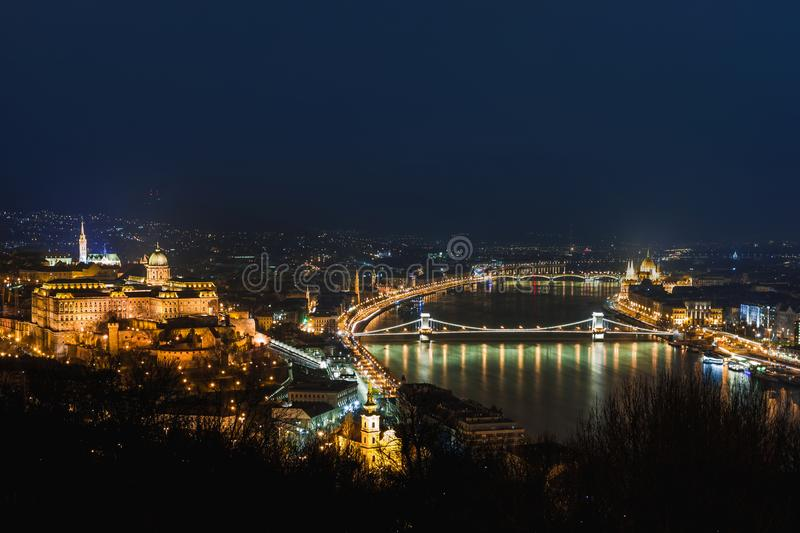 Night view of Budapest. Cityscape of famous tourist destination with Danube and bridges. Travel illuminated landscape in Hungary, royalty free stock photography