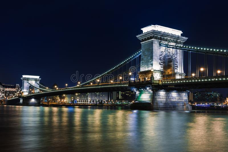 Night view of Budapest. Panorama cityscape of famous tourist destination with Danube and bridges. Travel illuminated landscape in royalty free stock image