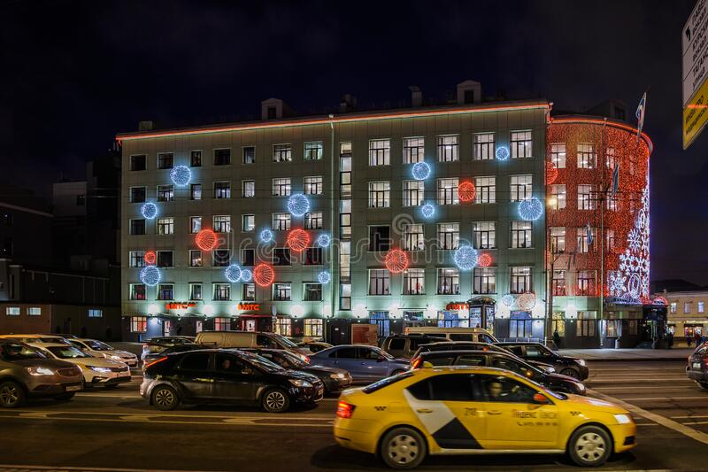 Night view of the building with Christmas and New Year`s light installation. Taganskaya square. stock images