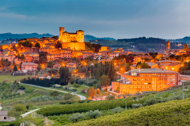 Night view of castle and roofs. Of houses in the tranquility of a medieval village in the hills of Romagna in Italy stock photo