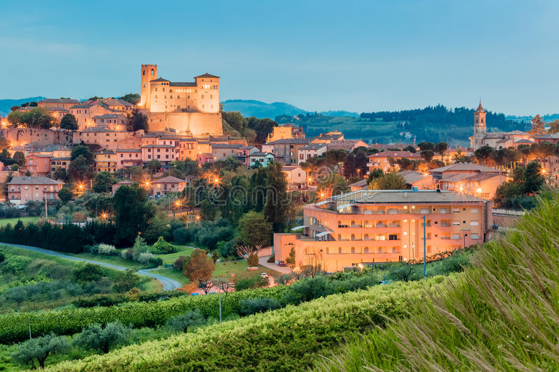 Night view of castle and roofs. Of houses in the tranquility of a medieval village in the hills of Romagna in Italy royalty free stock image