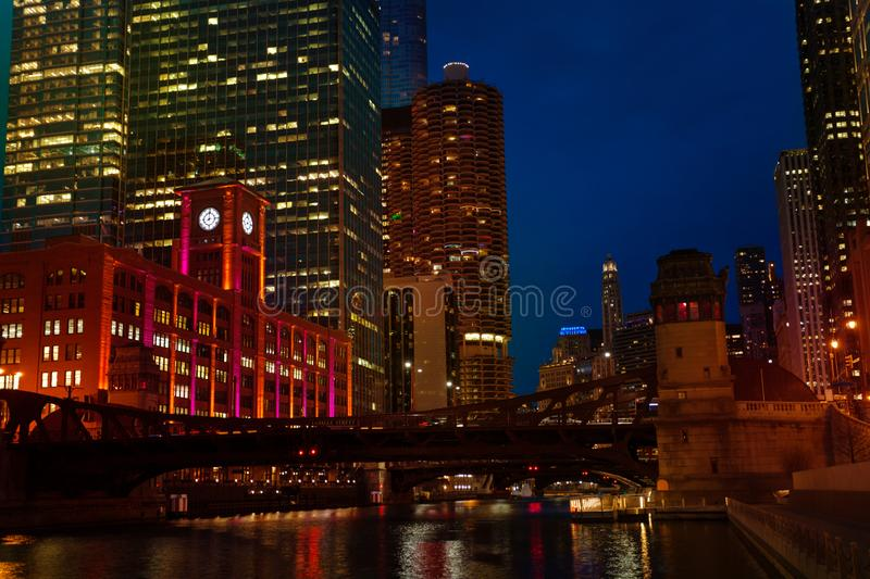 Night view of Chicago river and Marina City towers royalty free stock images