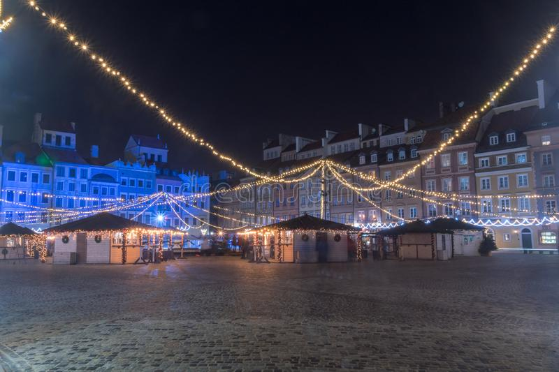 Night view of Christmas decorations in old market square in Warsaw, Poland.  royalty free stock image