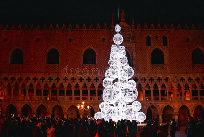 Night view of the Christmas Tree with beautiful light in front of Doge`s palace in San Marco Square full of people stock photography