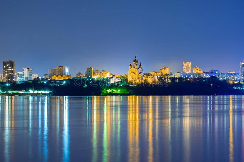 Night View of the city of Khabarovsk from the Amur river. Blue night sky. The night city is brightly lit with lanterns. Night View of the city of Khabarovsk royalty free stock photo