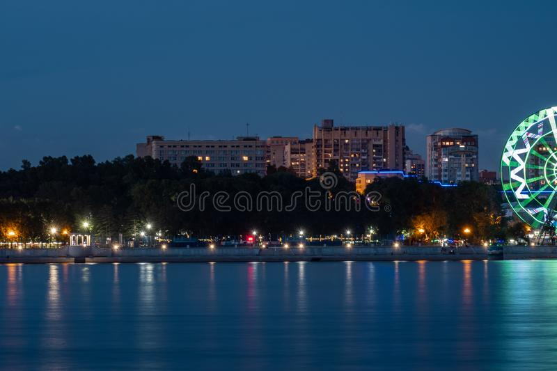 Night View of the city of Khabarovsk from the Amur river. Blue night sky. The night city is brightly lit with lanterns. Night View of the city of Khabarovsk royalty free stock image