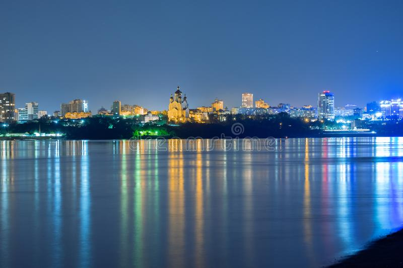 Night View of the city of Khabarovsk from the Amur river. Blue night sky. The night city is brightly lit with lanterns. Night View of the city of Khabarovsk royalty free stock photography