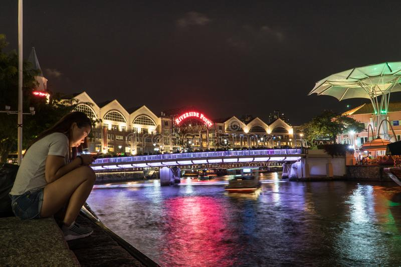 NIght view of a Clarke Quay, historical riverside quay of Singapore River royalty free stock image