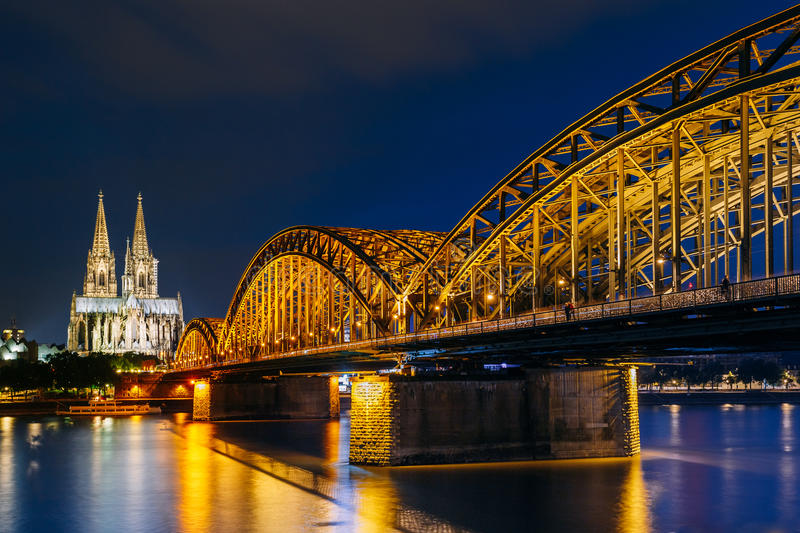 Night View Of Cologne Cathedral And Hohenzollern Bridge, Germany royalty free stock photos