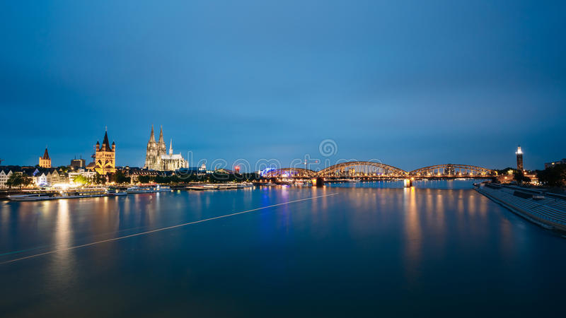 Night View Of Cologne Cathedral And Hohenzollern Bridge, Germany royalty free stock image