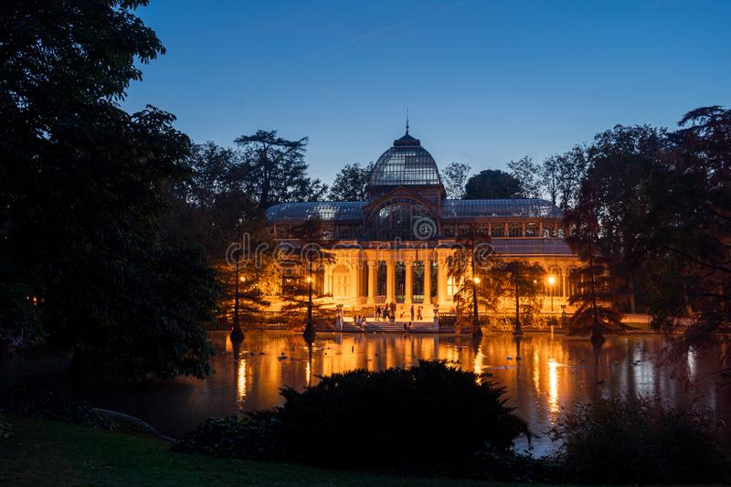 Night view of Crystal Palace or Palacio de cristal in Retiro Park in Madrid, Spain. stock photos