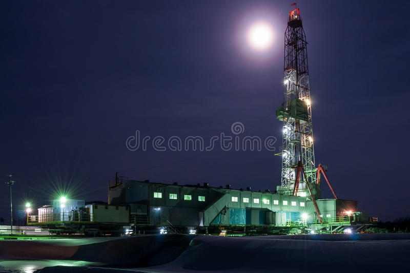 A night view of a derrick drilling in Siberia royalty free stock image