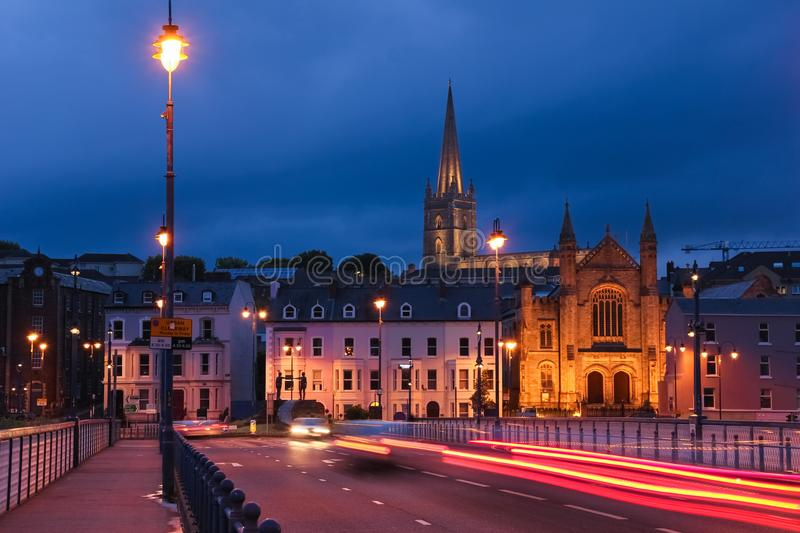 Night view. Derry Londonderry. Northern Ireland. United Kingdom. City centre at night. Bridge street and Saint Columb`s Cathedral illuminated. Derry Londonderry royalty free stock photo