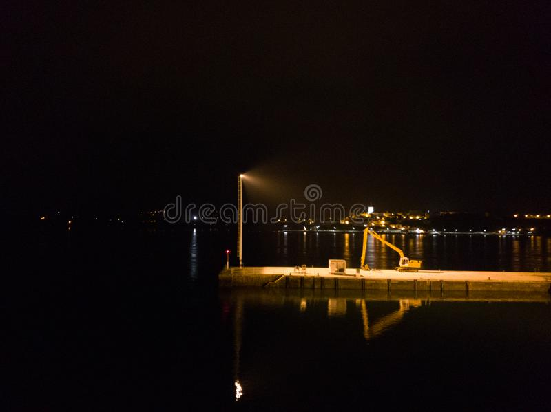 Night view of a dock. Dock lights reflected on the sea building cargo city cityscape dark export freight harbor harbour illuminated industrial industry loading stock photo