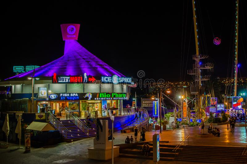 Night view on entertainment centre on the promenade of Eilat stock photography
