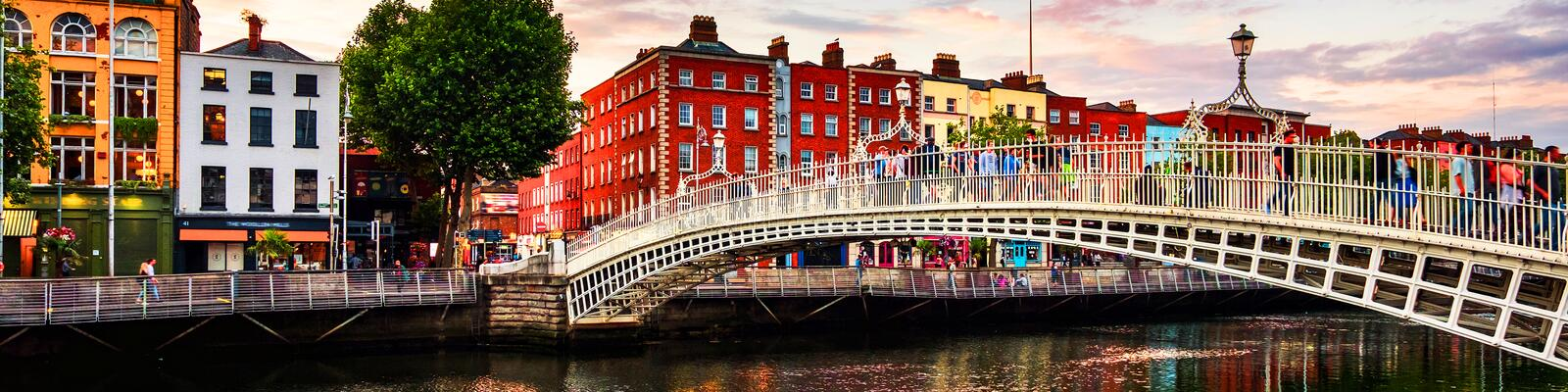 Night view of famous illuminated Ha Penny Bridge in Dublin, Ireland at sunset royalty free stock photos