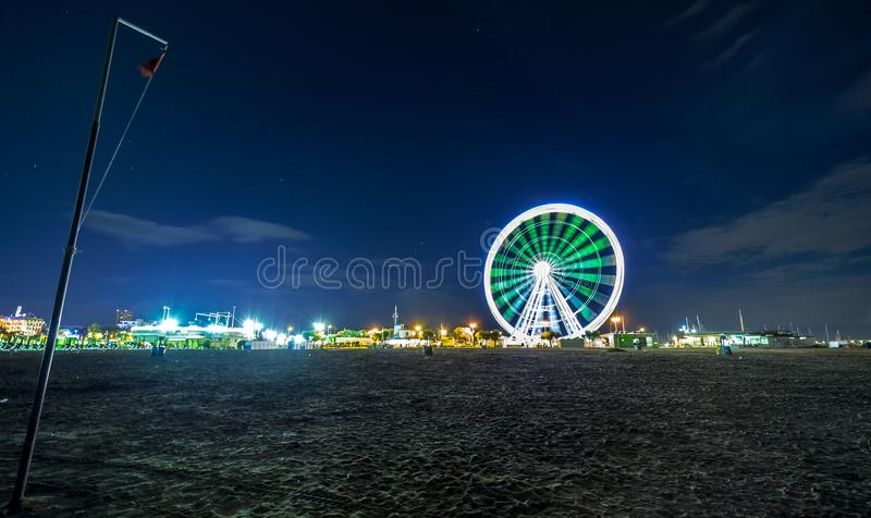 Night view of ferris wheel with city lights. Rimini. Fron seafront royalty free stock photos