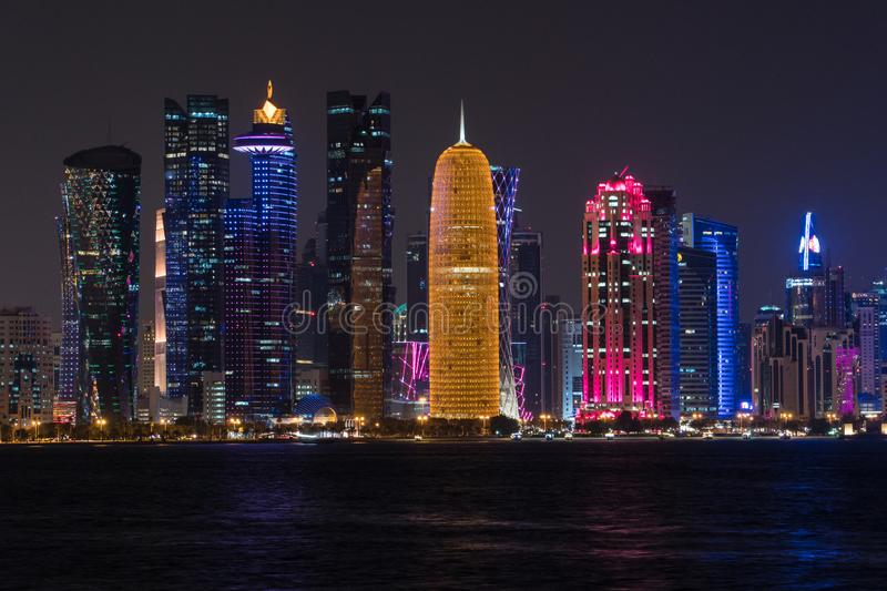 Night view on financial center of Doha from West Bay stock image
