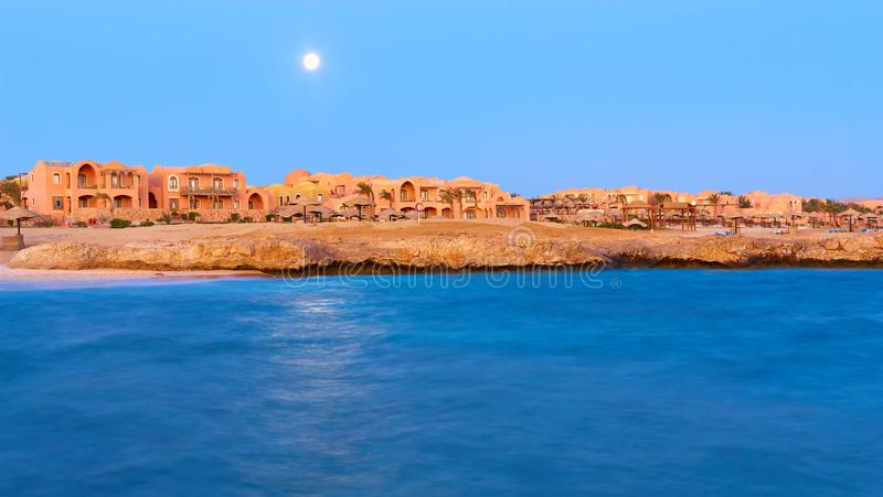 Night view of a five-star hotel on the coastline. Typical view o stock photography