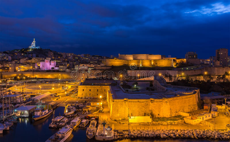Night view of Fort St. Nicolas and Notre-Dame-de-la-Garde. In Marseille, France stock photography