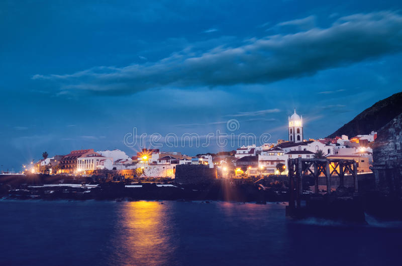 Night view of Garachico town. Tenerife Canary Islands, Spain. Filtered. stock photo