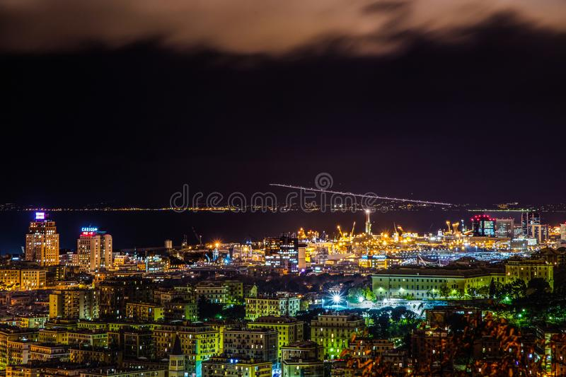 Night view of Genoa city center, buildings, skyscrapers and sea in Genoa, Italy stock images