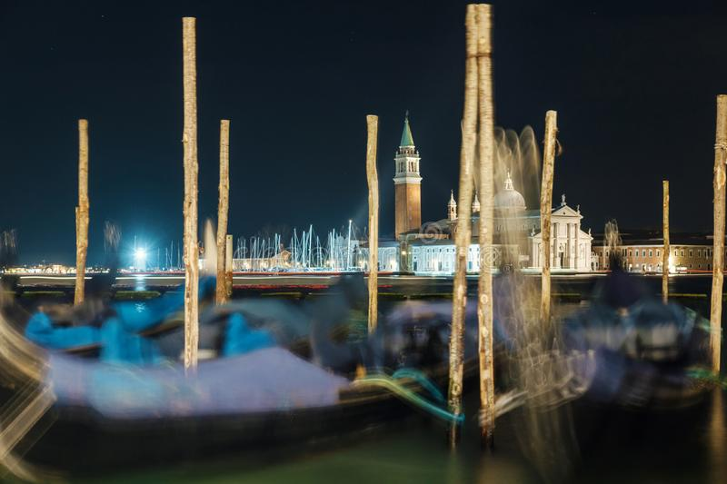 Night view of gondola pier at grand canal stock images