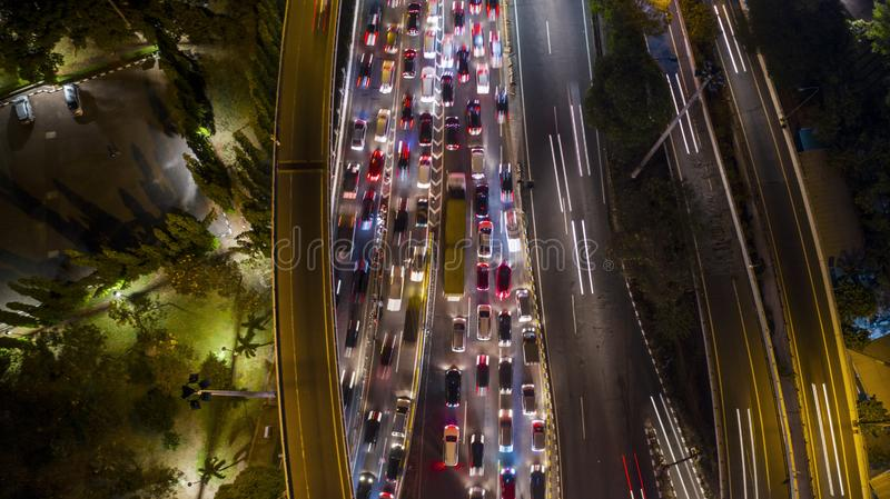 Night view of heavy traffic on the tollway. Night view of heavy traffic with cars on the tollway at the peak hour stock image