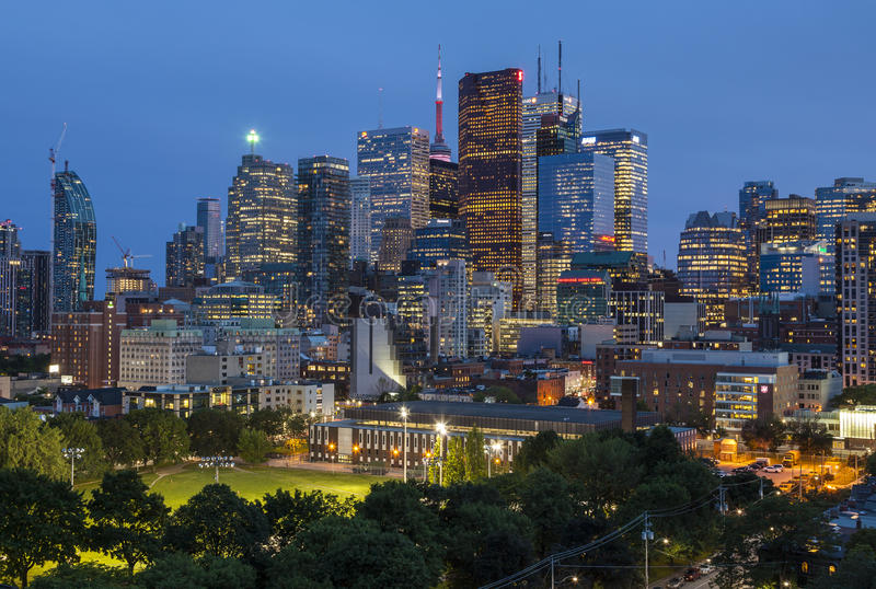 Night view from a high-rise building of Moss Park Arena with nearby skyscrapers royalty free stock images